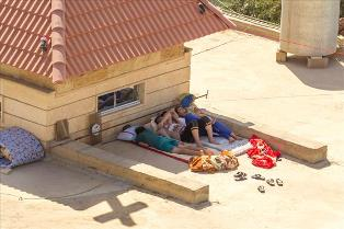 guys_sleeping_on_church_small
